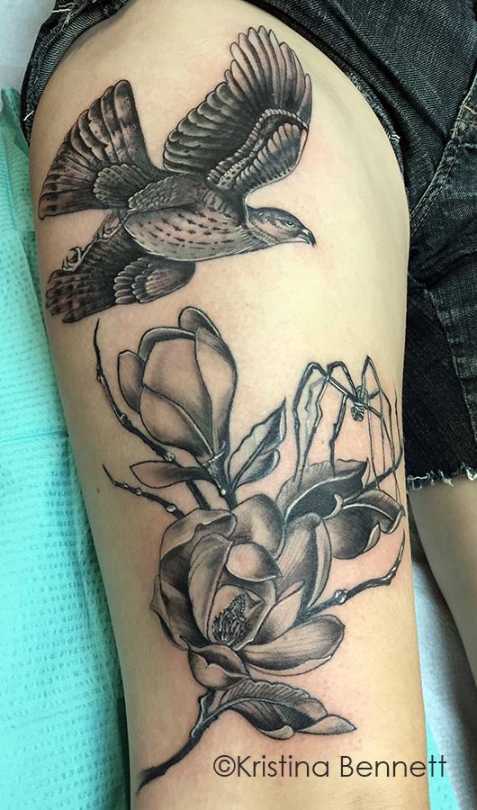 Hawk flowers tattoo