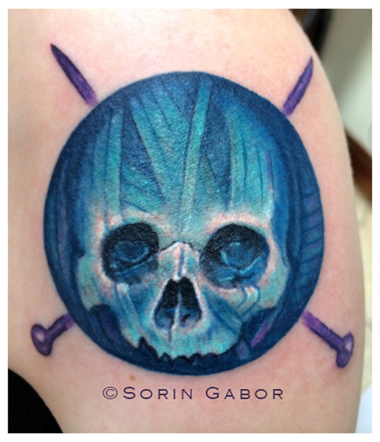 Yarn-skull tattoo